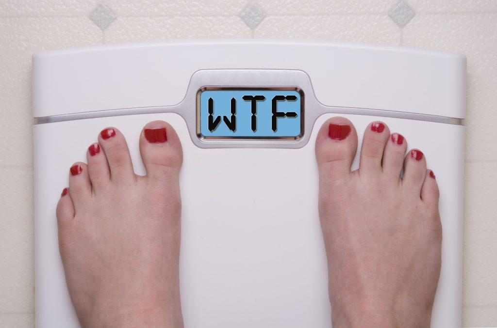 Digital Bathroom Scale Displaying OMG Message